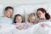 Family taking a nap together — Stock Photo