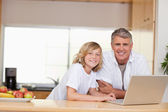Smiling father and son with laptop — Stock Photo