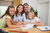 Family doing homework — Stock Photo