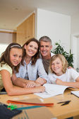 Family doing homework together — Stock Photo