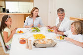 Family having a conversation while dinner — Stock Photo