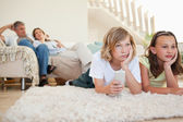 Siblings bored by tv program — Stock Photo
