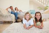 Siblings on the floor watching tv — Stock Photo