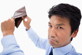 Broke businessman showing his empty wallet — Stock Photo