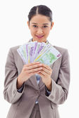 Portrait of a businesswoman holding bank notes — Stock Photo