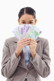 Portrait of a greedy businesswoman holding bank notes — Stock Photo