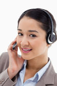 Portrait of a beautiful office worker posing with a headset — Stock Photo