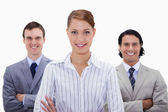 Smiling businessteam with arms folded — Stock Photo