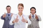 Businessteam giving thumbs up — Stock Photo