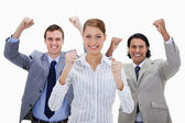 Businessteam with arms raised — Stock Photo