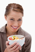 Smiling woman with bowl of fruit salad — Stock Photo