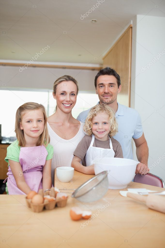 Happy smiling family preparing cookies together — Stock Photo #11211541