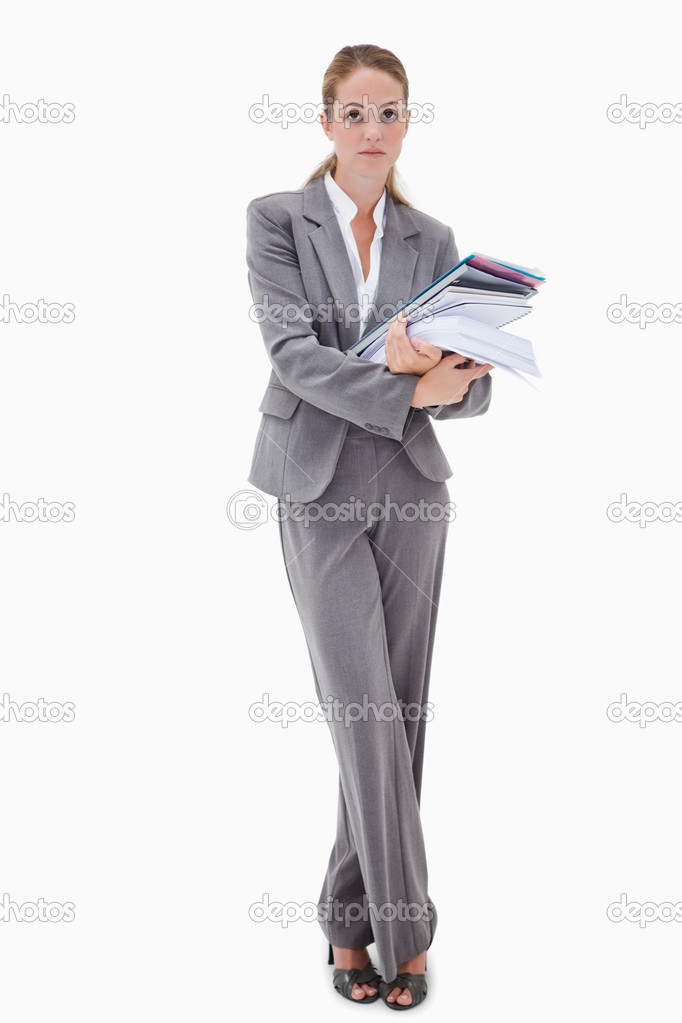 Office employee with pile of paperwork against a white background — Stock Photo #11214673