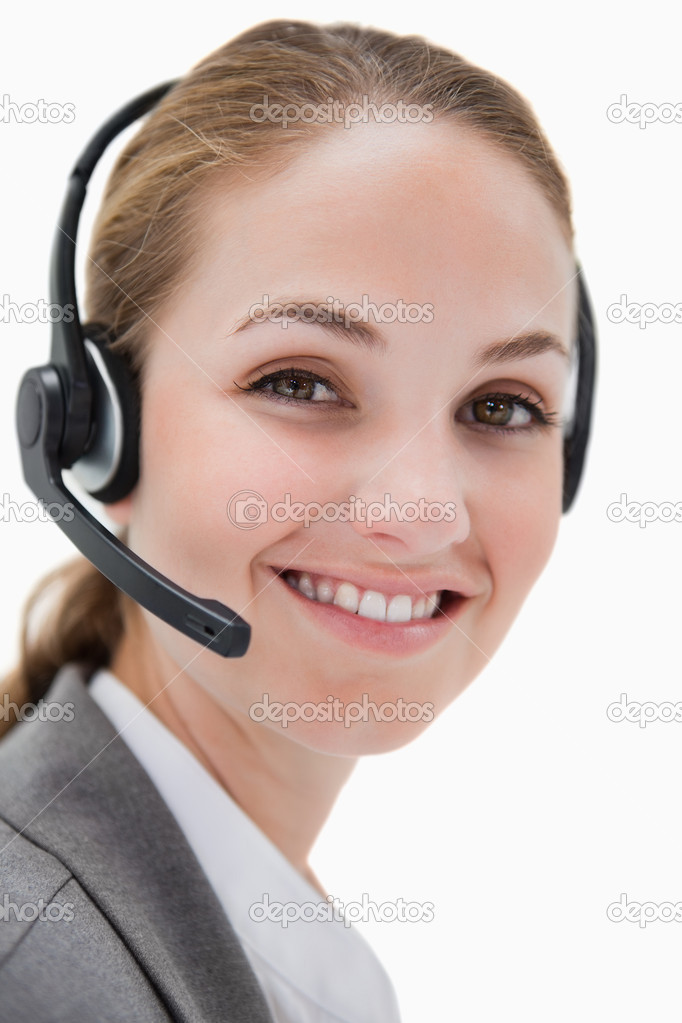 Smiling female call center agent working against a white background — Stock Photo #11214691