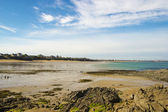 Northern coast of France, the shoreline at low tide — Stock Photo