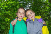 Portrait of two hugging boys, tweens — Stock Photo