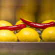 Bright lemons and chili peppers — Stock Photo