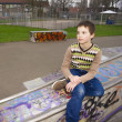 Cute Boy Sitting In Playground — Stock Photo #11683986