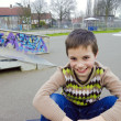 Stock Photo: Cute Smiling Boy Sitting In Playground