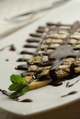 Pancake with chocolate sauce — Stock Photo