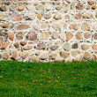 Stone wall with lawn — Stock Photo
