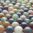 Beads from a multi-colored stone — Stock Photo