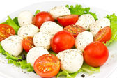 Mozzarella, tomato and salad — Stock Photo