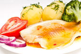 Potatoes with dill, fish fillet, tomato and onion — Stock Photo