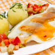 Fillet of sea fish with vegetables and potatoes - Stock Photo