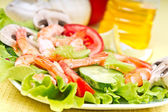 Salad with king prawns and vegetables — Stock Photo