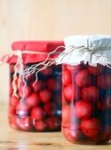 Two jars of cherry compote — Stock Photo