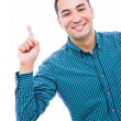 Stock Photo: Businessman with finger pointing up, isolated