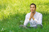 Medieval young man praying in a forest-SMALL DOF — Stock Photo