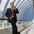 Attractive young businessman using a cell phone - Stock Photo