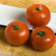 A photo of three tomatoes - Stock Photo