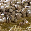 A photo of pistachio nuts - Stock Photo