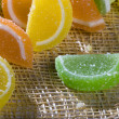 A photo of orange, green and yellow marmalade - Stock Photo