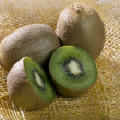 A photo of three kiwi - Stock Photo