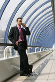 Attractive young businessman using a cell phone — Stock Photo
