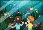 At the aquarium — Stock Vector
