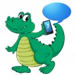 A crocodile with cell phone — Stock Vector