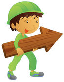 Boy carrying arrow — Stock Vector