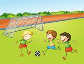 Chłopcy gry w piłkę nożną — Wektor stockowy
