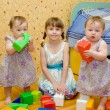 Three sisters building of the blocks — Stock Photo