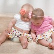 Twin baby girls talking — Stock Photo