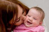 Mother kissing newborn baby — Stock Photo