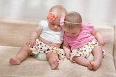 Twin baby girls talking — Stock Photo