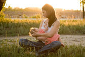 Breast feeding at sunset — Stock Photo