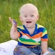 Happy baby with Down syndrome - Stock Photo