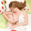 Breast feeding baby in bed — Stock Photo
